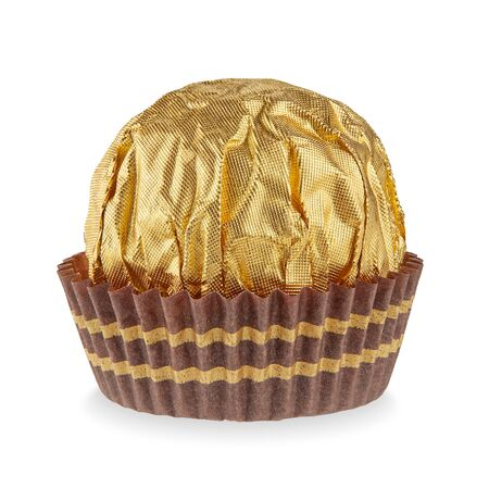 Beautiful candy in gold wrapper ball shape in paper skirt isolated on white with shadows. Full sharpness across the surface. Imagens