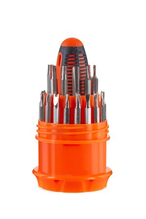 Screwdriver bits in container isolated on background. Metallic interchangeable screw driver bits close up. Toolkit set for diy work and repair. A set of screw tips in a yellow container.
