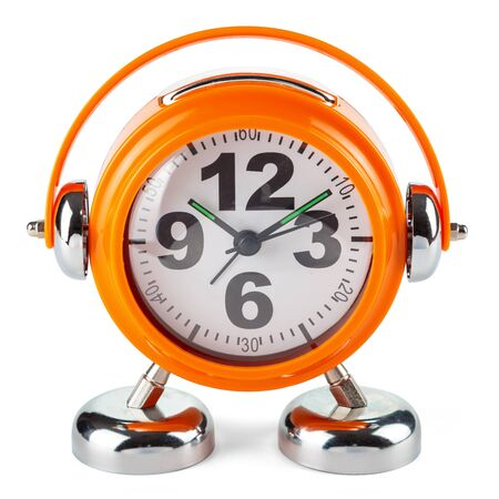 Alarm clock is made of orange plastic with bells in the shape of headphones isolated on a white background. Front view.