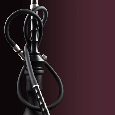 Fragment of a modern hookah, made with the latest technology on a beautiful dark background. Фото со стока