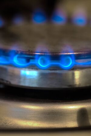 Blue flame of gas on a cooker. Vertical image. Imagens