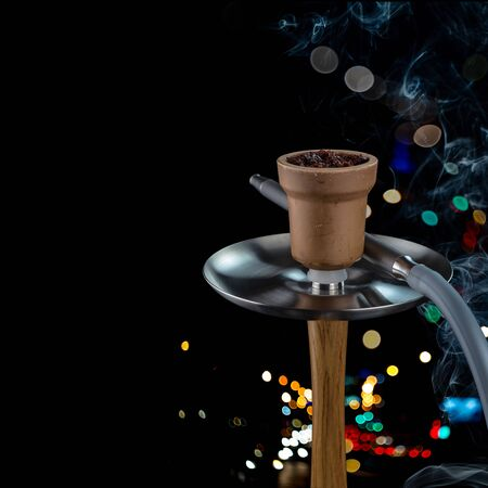 Modern hookah for Smoking, made in black from metal, glass and rubber. Luxury version of hookahs.