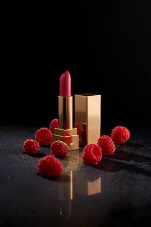 Lipstick. Fashion Colorful Lipsticks over black background. Professional Makeup and Beauty. Beautiful Make-up concept. Lipgloss. Lipsticks closeup.