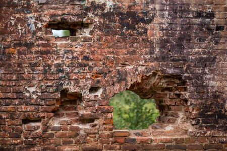 Old brick walls, damaged by war and time.