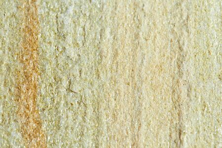 Uneven rough surface of the stone without treatment. Stone texture for background.