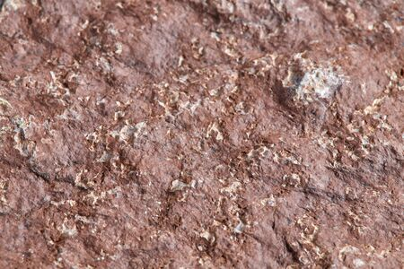Uneven rough surface of the stone without treatment. Stone texture for background. Stockfoto