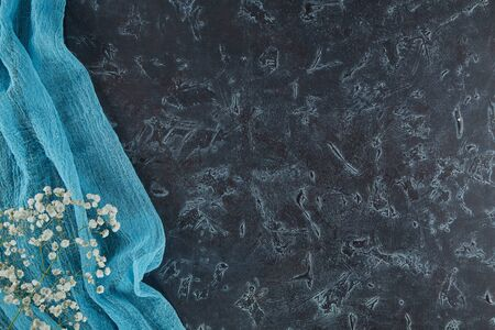 Rough texture chalkboard is draped with a light bright fabric with space for your text. Banner background.