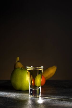Portion of strong alcohol on a beautiful dark background. 写真素材