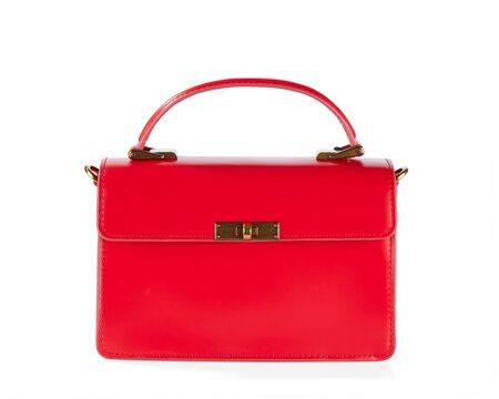 Elegant women's bags made of red leather, isolated on a white background with shadows.