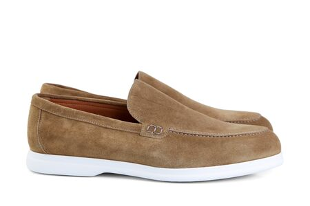 Mens elegant beige suede shoes on white rubber sole. Side view. Stock Photo