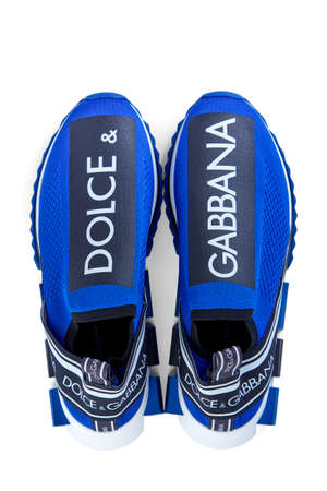 Modern men's sneakers dolche & gabbana blue color, made of synthetic materials isolated on a white background with shadow. Model sorrento.