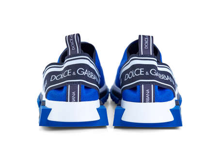 Modern men's sneakers dolche gabbana blue color, made of synthetic materials isolated on a white background with shadow. Model sorrento.