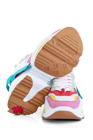 Pair of bright modern DSQUARED sneakers is insulated on a white background with shadows. Editorial