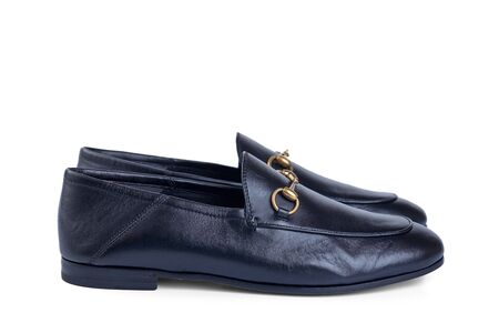 Mens lightweight shoes in fine blue leather with an elegant metal buckle insulated against a white background with shadow. Side view.