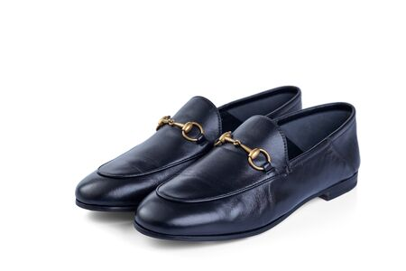 Mens lightweight shoes in fine blue leather with an elegant metal buckle insulated against a white background with shadow. Top view at an angle.