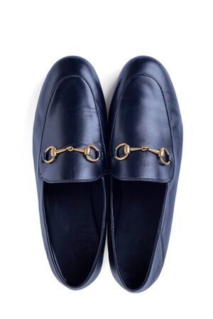 Mens lightweight shoes in fine blue leather with an elegant metal buckle insulated against a white background with shadow. Top view. Imagens