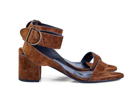 Pair of womens open sandals in high heel of brown suede, isolated on a white background by a light shadow. Side view.