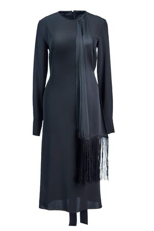 Long black evening silk fitted dress with long sleeves and a satin train with fringe, isolated on a white background.