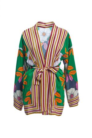 Short silk robe dress in bright green-orange floral colors with long sleeves and a belt, isolated on a white background.