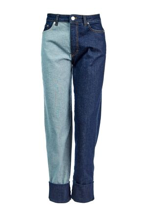 Women's jeans with one leg of the Indigo color, and the other leg of the material inside out isolated on a white background on an invisible mannequin.