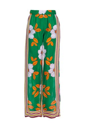 Beautiful women's summer silk trousers with bright colors isolated on a white background. Luxury clothing for women.