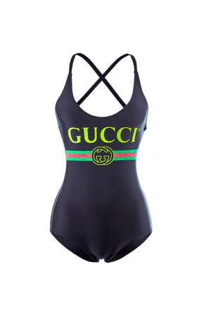 Gucci black women's closed swimsuit with a logo on the chest, isolated on a white background. Editorial