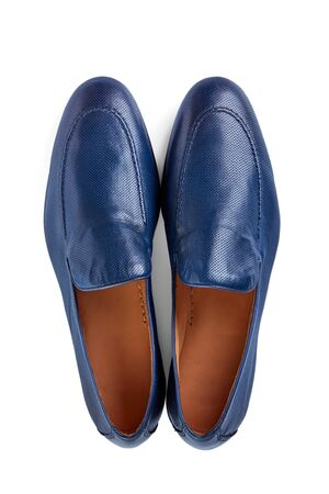 Men's light shoes in thin blue perforated leather. Imagens