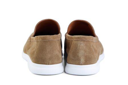 Men's elegant beige suede shoes on white rubber sole.