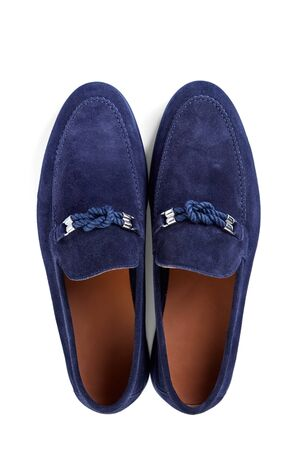 Men's classic blue suede shoes with a decorative rope buckle and a blue rubber sole. Imagens