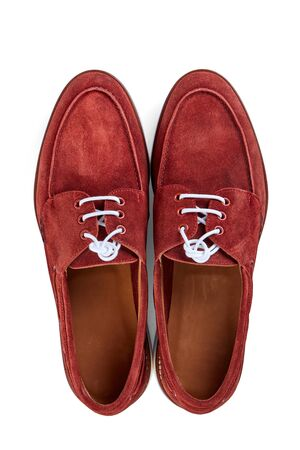 Men's classic reddish-brown suede shoes with white rubber sole.
