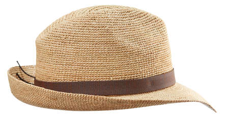 Beautiful wide-brimmed wicker hat fedora woven from straw, isolated on a white background. Handmade work. Standard-Bild