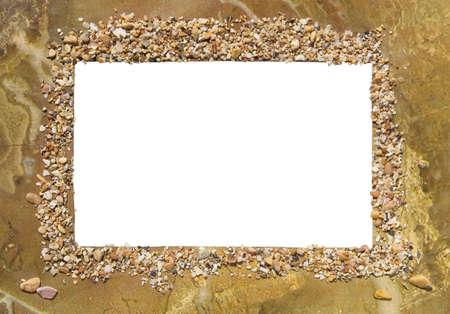 Original photo frame decorated with marine mollusks and stones Standard-Bild