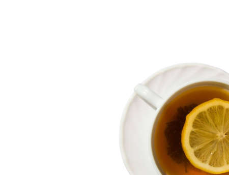 White cup of tea with lemon on a white background Standard-Bild