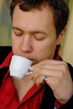 portrait of young man with cup of coffee