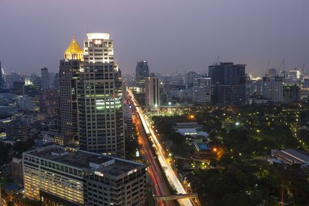 City skyline and Lumpini Park at dusk, Bangkok, Thailand