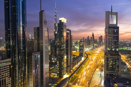Elevated view at dusk over Downtown & Sheikh Zayed Road looking towards the Burj Kalifa, Dubai, United Arab Emirates, UAE