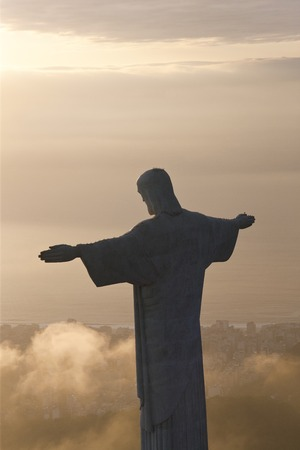 The giant Art Deco statue of Jesus, known as Cristo Redentor (Christ the Redeemer), on Corcovado mountain in Rio de Janeiro, Brazil. The statue is 125 feet tall and was completed in 1931.
