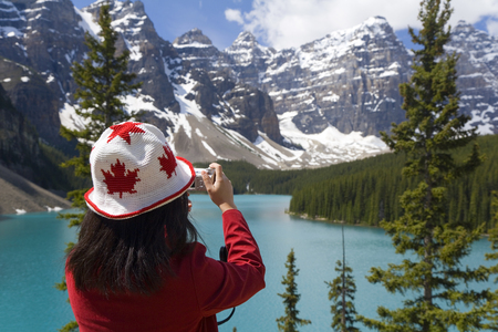Alberta, Canada - June 2007: Photographing view of Moraine Lake, Banff National Park,