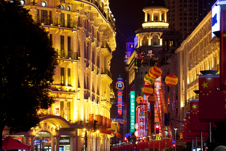 Shanghai, China - January, 2012: Buildings lit up at night with Chinese flags, Nanjing Road, Shanghai, China 版權商用圖片 - 83053230
