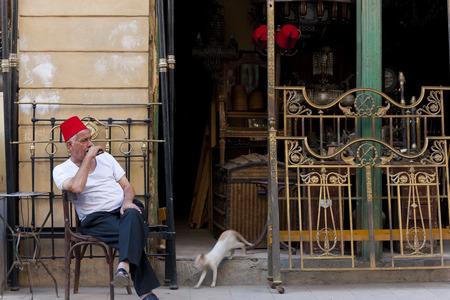 Cairo, Egypt - November, 2009: Man wearing fez, Khan Al-Khalili bazaar, Editöryel