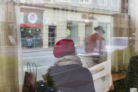 Salzburg, Austria - May, 2013: Woman sat in cafe, 版權商用圖片 - 83053240