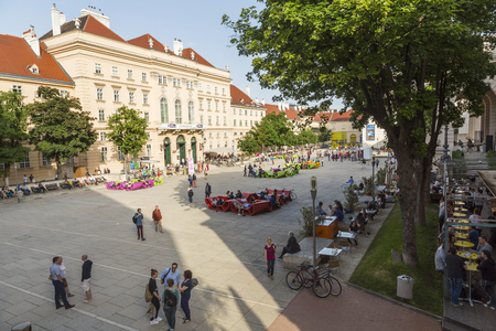 Vienna, Austria - May, 2013: Museum quarter with restaurants & cafes, Vienna, Austria 版權商用圖片 - 83053245
