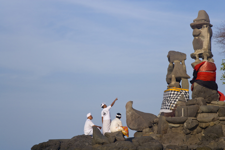 North West Bali, Indonesia - September, 2007: Men worshiping at Paben temple by the sea