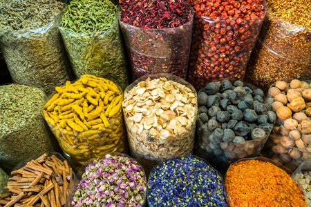 Bags of colorful spices at market in Dubai, United Arab Emirates