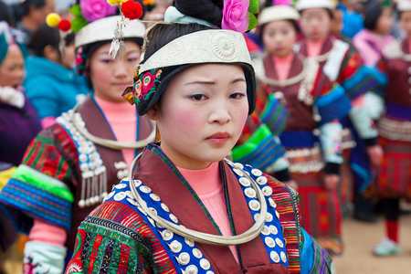 Black Miao girls dancing at festival, Kaili, Guizhou Province, China
