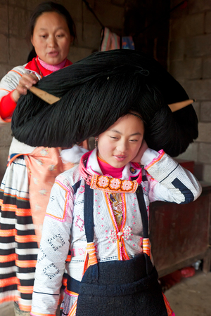 Preparing hair, Long Horn Miao, Sugao, Guizhou Province, China Editorial