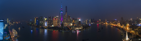 View over Huangpu River & Pudong skyline at night, Shanghai, China