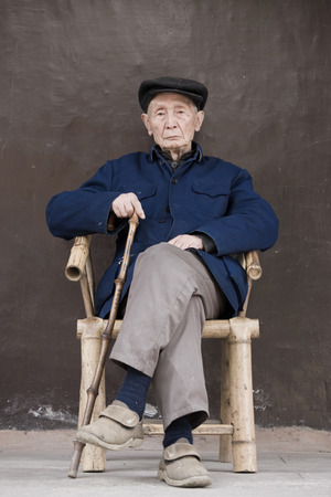 Old Chinese man in chair, Chengdu, Sichuan, China Editorial