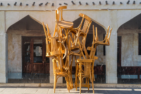 Stacked restaurant chairs, Doha, Qatar Editorial