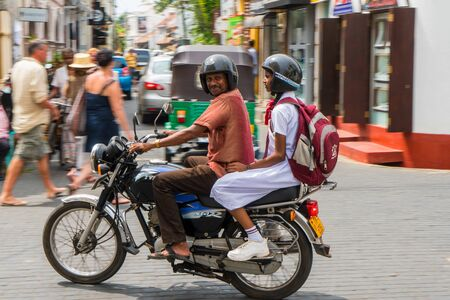 Man and girl on motorcycle, Galle, South Coast of Sri Lanka Editorial